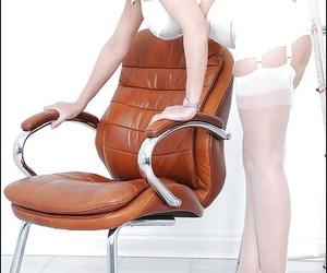 Lecherous mature blonde poses in white lingerie and nylon stockings