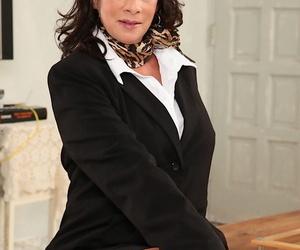 Mature businesswoman Margo Sullivan strips naked and pleasures herself