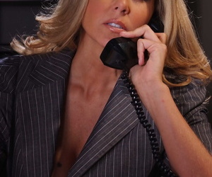 Blonde businesswoman Julia Ann strips naked on top of her office desk