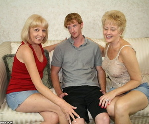 Two blonde grannies share a horny students hard white dick on the sofa