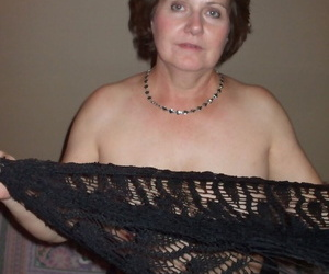 Erotic mature wife Busty Bliss shes lace shawl to spread topless in sexy thong