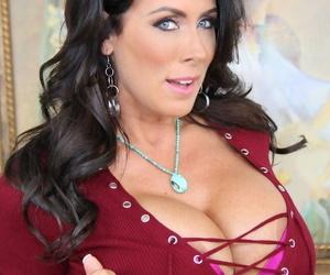 Beautiful mature Reagan Foxx exposes massive big tits & MILF ass on the settee