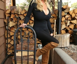 Blonde chick in knee high suede boots pulls out her massive tits