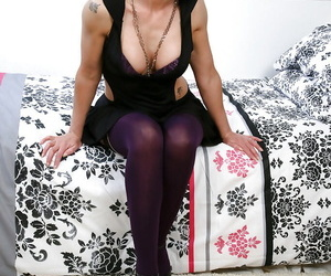 Brunette mature lady in stockings undressing and toying her hungry twat