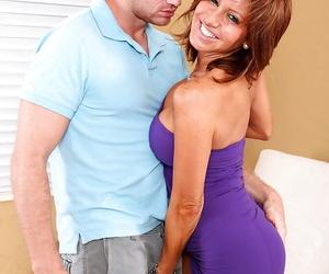 Busty Latina cougar Tara Holiday giving younger mans big cock a bj