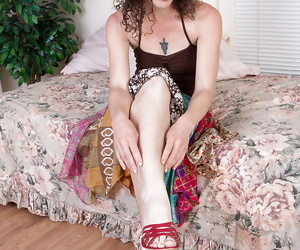 Mature solo model Sunshine licking her own painted toenails