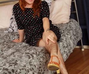 Hirsute model Velma posing hairy legs in heels and spreading beaver
