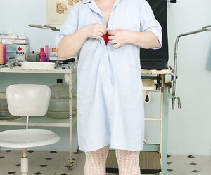 Fatty mature nurse taking off her uniform and toying her hairy vag