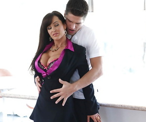 Clothed mature Lisa Ann fucks with her hardcore penetrator!
