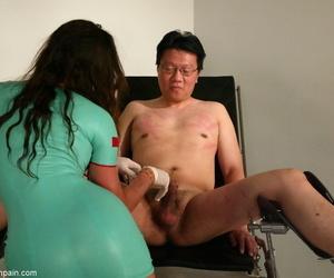 Kinky nurse Kym Wilde flogs a naked Korean man in a latex dress and gloves