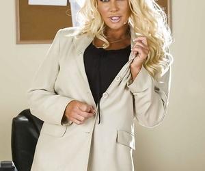 Curvaceous mature blonde JR Carrington taking off her suit and lingerie