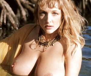 Mature blond chick Danni Ashe unveiling huge natural tits outdoors on beach
