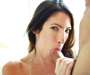 Cumshot scene with a brunette mature Dava Foxx doing blowjob