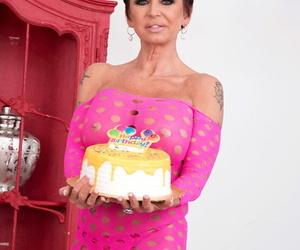 Older white woman Gina Milano celebrates her birthday with a huge dildo