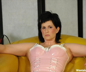 Older female with dark hair gives head and masturbates in latex lingerie