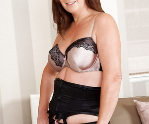 Mature lady Carol Foxwell stripping off her lingerie and toying her twat