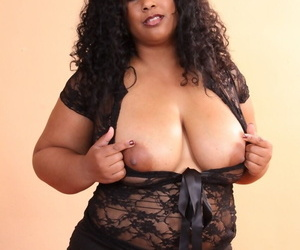 Ebony BBW Delilah Black revealing her huge oily boobs and fat pussy