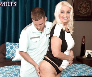 Mature blonde lady Vikki Vaughn exposing saggy tits before giving blowjob