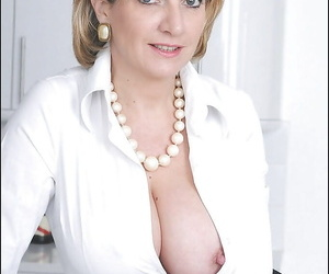 Stupendous mature lady has no lingerie under her formal suit