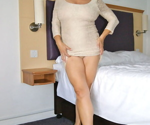 Huge titted mature bimbo Michelles Nylons welcomes a dildo in her wet twat