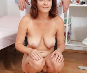 Sassy mature lassie gets her shaved cunt stuffed with gyno tools and sex toys