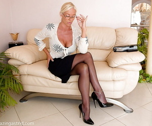 Petite mature lady in glasses slowly stripping off her clothes