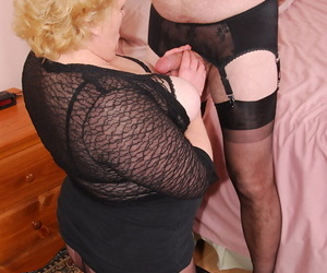 Mature blonde Fanny ties up a crossdressers dick before stimulating his balls