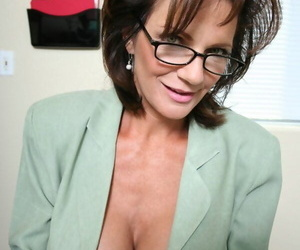 Mature office slut Deauxma denudes her booming juggs and ass