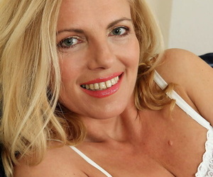 Slutty mature wife sheds white lingerie to squat nude baring bald beaver