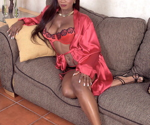 Busty black lady toys her filthy asshole and pink vagina at the same time