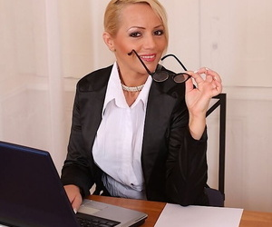 Mature office slut in glasses with big tits teases her shaved cunt