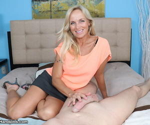 Mature MILF Dani Dare takes hold of a big dick and jerks it in POV mode