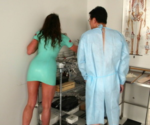 Dark haired nurse Kym Wilde attends to a patient in latex outfit and heels