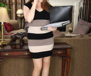 Chubby mature mom Holly Fuller reveals her great big tits at the office