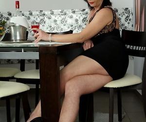 Mature MILF Zoe Gyro masturbates shaved vagina after undressing