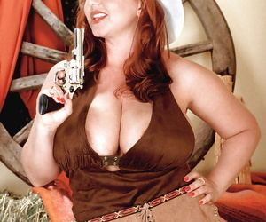 Chesty redheaded cowgirl with gun Cherry Brady exposing huge mature juggs