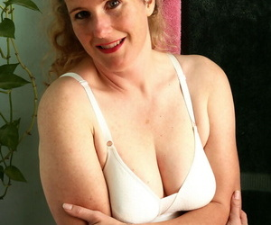 Mature lady Magnolia takes off her bra and panties sitting on her toilet seat