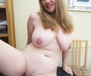 Chubby mature mom Lily May offers big saggy tits & spreads her bald pussy lips