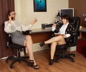 Overweight secretaries Simone Delilah and Valentine have lesbian sex at work