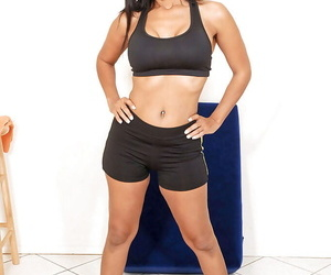 Fit middle aged lady Anjanette doffing sports bra and shorts to pose nude