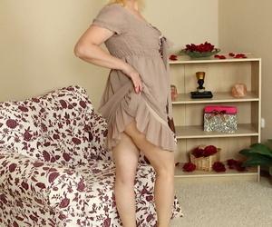 Older blonde MILF Kim Brosley stripping naked for masturbation session