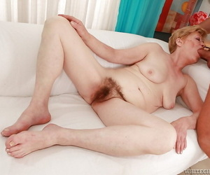 Mature blonde gets a cumshot on her hairy twat after hardcore fucking