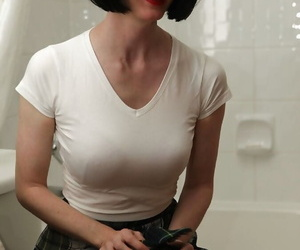 Filthy mature lady in glasses getting her clothes wet in the shower