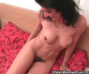 Grandma Gets Her Old And Hairy Pussy Fingered By The Photographer