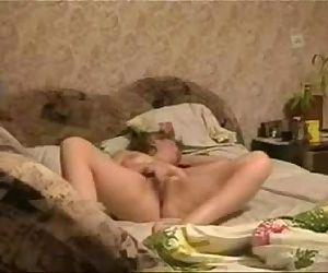 Watch my horny mum masturbating on bed. Hidden cam - 43 sec