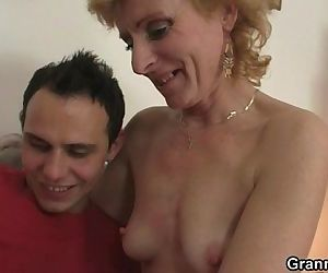Blonde granny jumps on young cock - 6 min