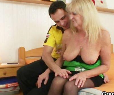 Blonde grandma in black stockings fucks