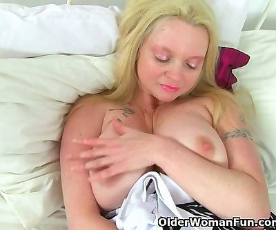 English milf Summer Angel Lee plays with her toy collection