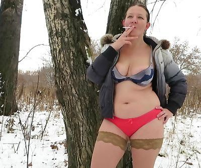 smoke in the winter in the woods in his underwear