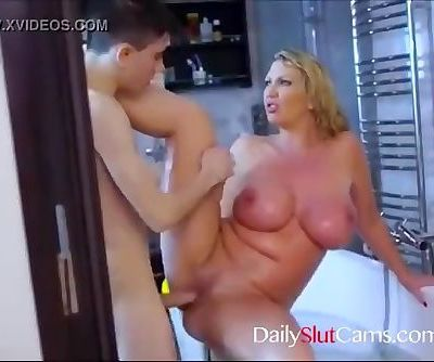 Hot step mom playing with her young son in bath...